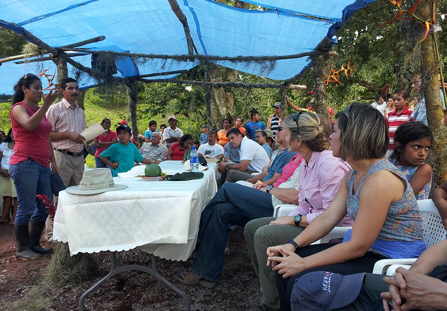 ELM attorneys, seated at right, listen to a presentation given by the community of Tierra Nueva, a village near Agroaldea San José.